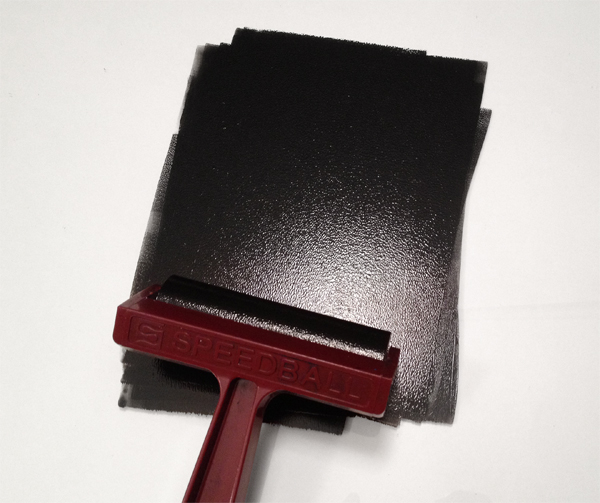 4. Proof Your Block - Step 3 - Roll out the ink with the brayer.