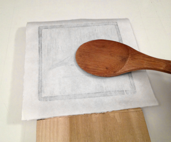 5. Print Your Block - Step 4 - Apply ink to your paper by pressing your paper onto your ink.