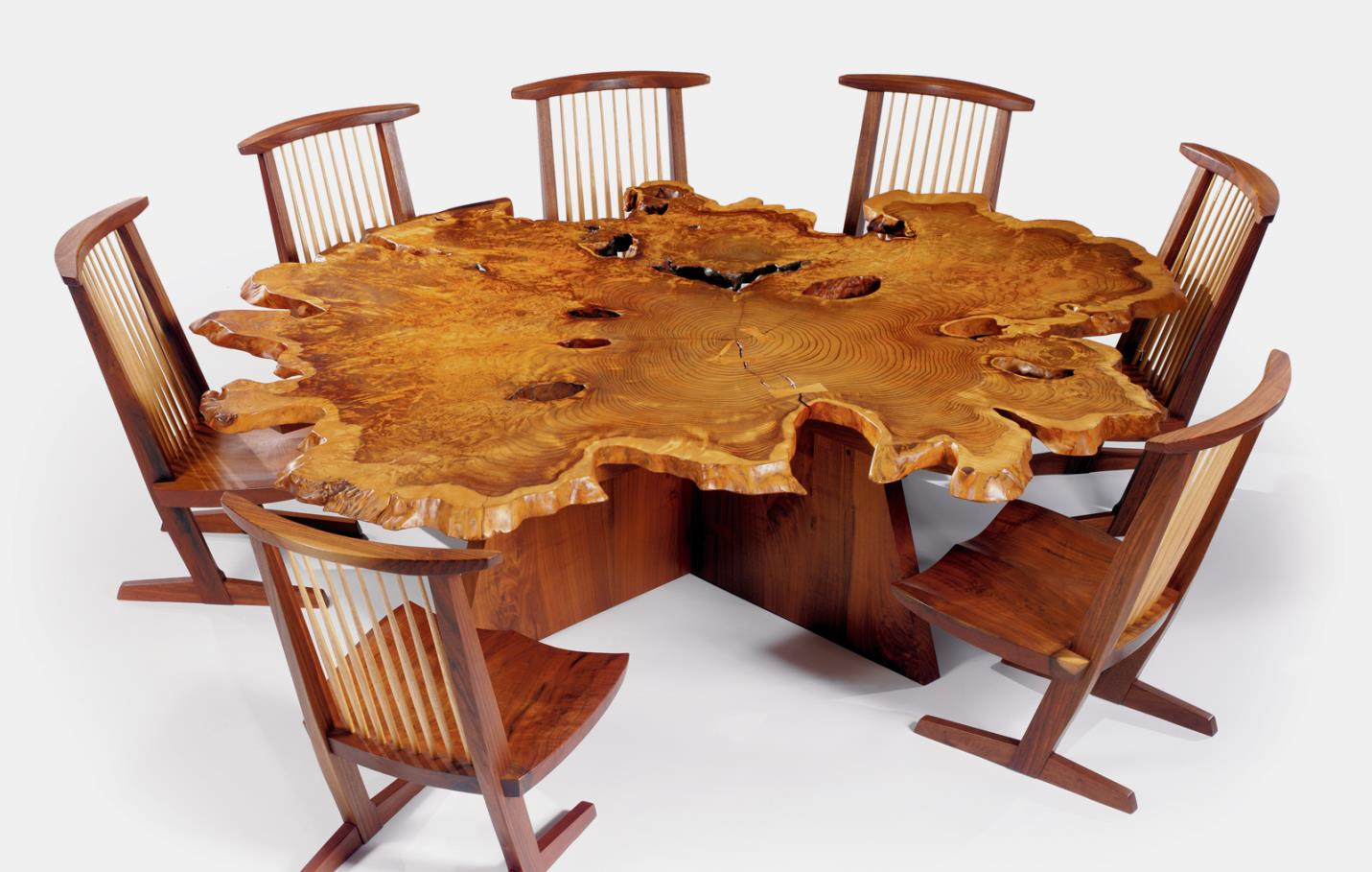 "George Nakashima's ""Arlyn"" table - redwood, black walnut, madrone burl, and east indian laurel; 26"" x 89"" x 91"". Conoid chairs - walnut and hickory; 35 ½"" x 20"" x 21""."