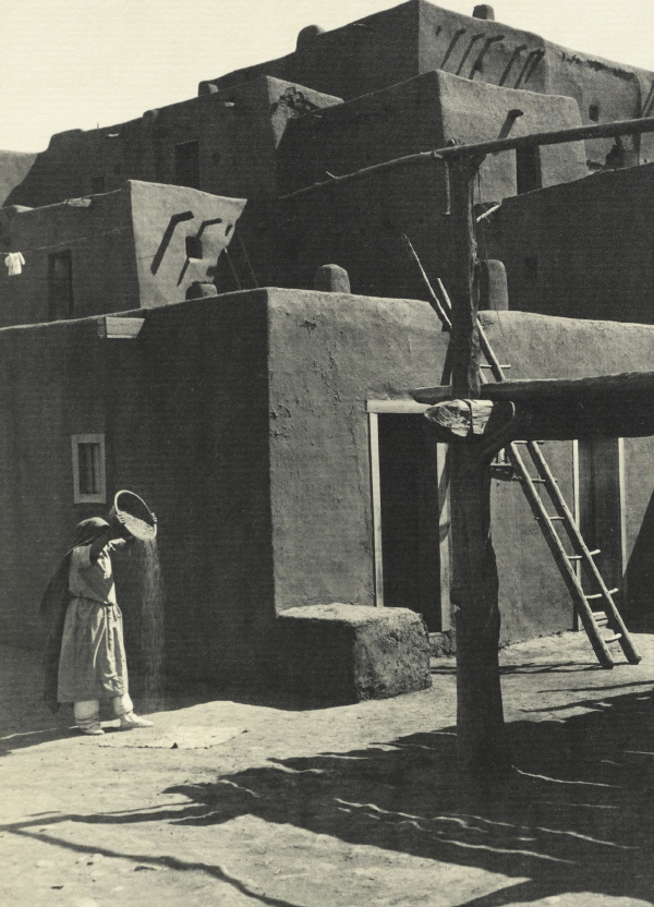 Ansel Adams' Taos Pueblo - Plate X - South House, Woman Winnowing Grain