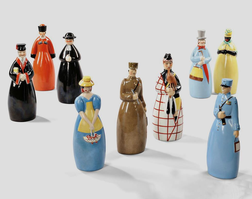 Nine Robj Decanters, Glazed Ceramic, c. 1928-1931, The anthropomorphic containers in various colorful glazes represent: a French general (a paper label with image of General Foch on back), African woman, professor, Russian peasant, bagpiper, a general with field telescope, priest, a beauty with basket,and a gentleman in a top hat, all marked Robj Paris Made in France, approx. ht. 11 in. From the Art Deco Coda Collection from Corinne Davidov